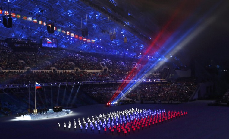 The colours of the Russian flag are seen during the opening ceremony of the 2014 Sochi Winter Olympics, February 7, 2014. (REUTERS/Mark Blinc)