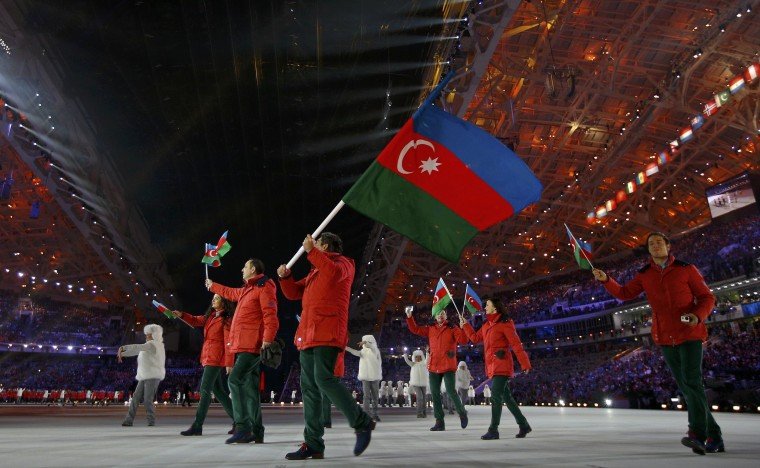 Azerbaijan's flag-bearer Patrick Barchner leads his country delegation during the opening ceremony of the 2014 Sochi Winter Olympic Games at Fisht stadium February 7, 2014. (REUTERS/Brian Snyder)