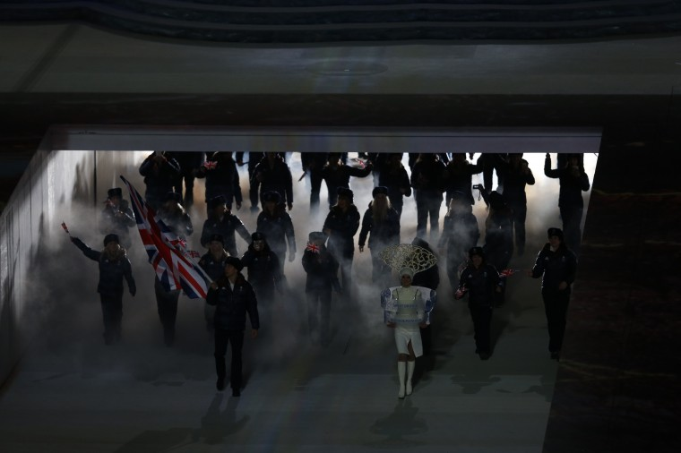 Great Britain's flag bearer, speed skater Jon Eley, leads his delegation during the Opening Ceremony of the Sochi Winter Olympics at the Fisht Olympic Stadium on February 7, 2014 in Sochi. (Adrian Dennis/AFP/Getty Images)