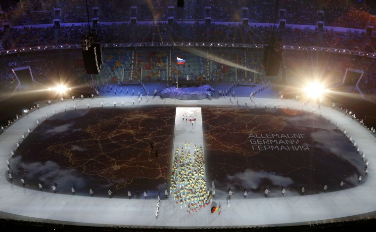 A map of Germany is projected onto the stadium floor as athletes march in during the opening ceremony of the 2014 Sochi Winter Olympics, February 7, 2014. (REUTERS/Pawel Kopczynski)