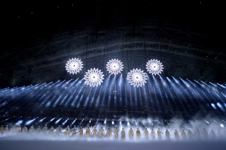 Snowflakes are moved into position to form the Olympic rings during the opening ceremony for the Sochi 2014 Olympic Winter Games at Fisht Olympic Stadium. (Robert Deutsch/USA TODAY Sports)