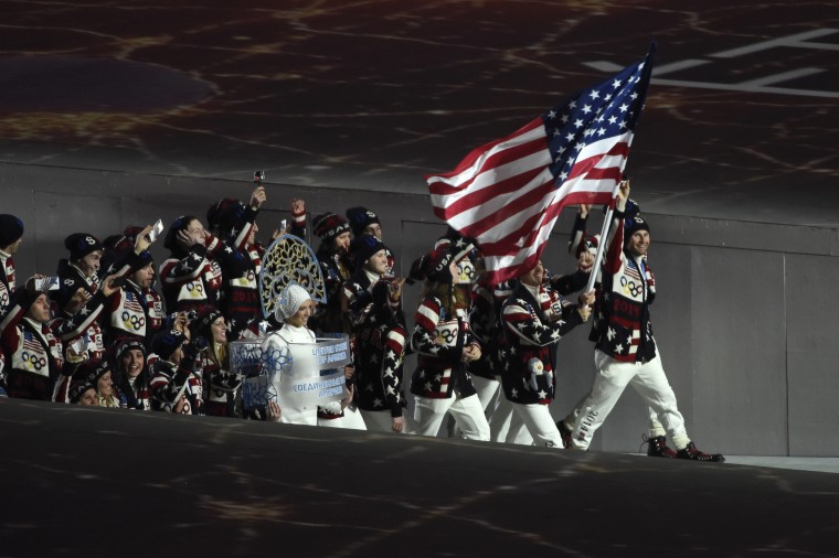United States flag bearer Todd Lodwick leads the U.S. Olympic team onto the stage during the opening ceremony for the Sochi 2014 Olympic Winter Games at Fisht Olympic Stadium.(Robert Hanashiro/USA TODAY Sports)