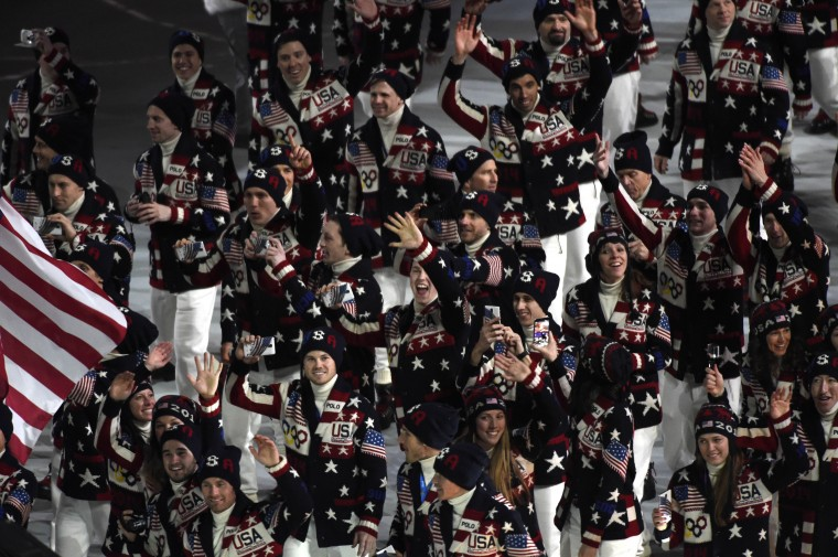 United States flag bearer Todd Lodwick leads the U.S. Olympic team onto the stage during the opening ceremony for the Sochi 2014 Olympic Winter Games at Fisht Olympic Stadium. (Robert Hanashiro/USA TODAY Sports)