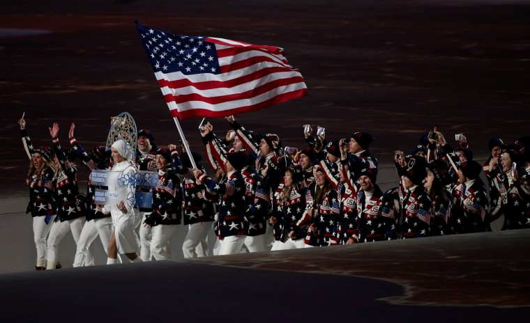 Todd Lodwick leads the delegation from the USA during the opening ceremony for the Sochi 2014 Olympic Winter Games at Fisht Olympic Stadium. (Jerry Lai/USA TODAY Sports)