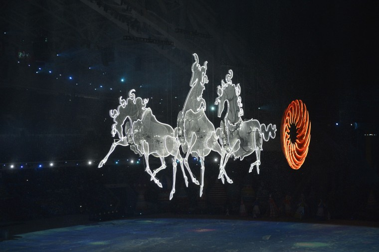 A troika enters the stage followed by a sun during the opening ceremony for the Sochi 2014 Olympic Winter Games at Fisht Olympic Stadium. (Robert Hanashiro/USA TODAY Sports)