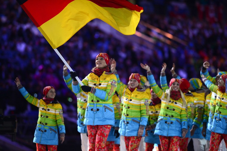 Germany's flag bearer, alpine skier Maria Hoefl-Riesch, leads her national delegation during the Opening Ceremony of the 2014 Sochi Winter Olympics at the Fisht Olympic Stadium on February 7, 2014 in Sochi. (John Macdougall/AFP/Getty Images)