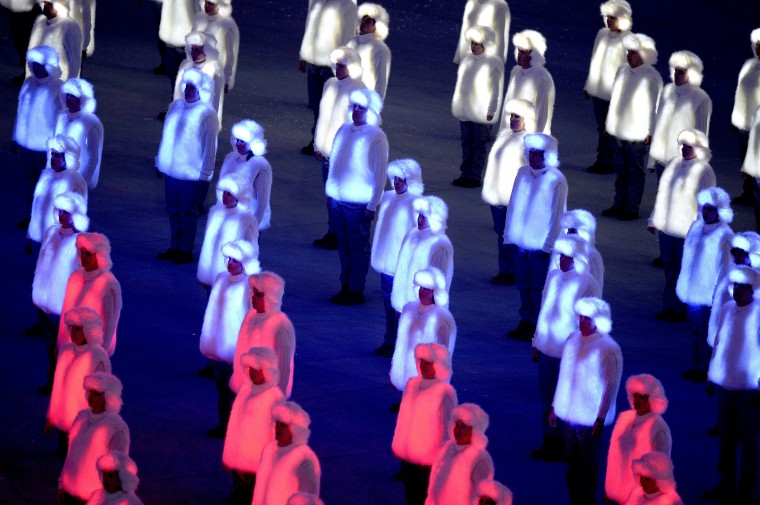 Performers costumed in illuminated red, white and blue outfits form the Russian national flag during the Opening Ceremony for the Winter Olympics at Fisht Olympic Stadium in Sochi, Russia, Friday, Feb. 7, 2014. (Chuck Myers/MCT)