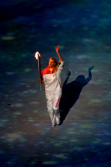 Maria Sharapova carries the Olympic torch into the stadium during the Opening Ceremony of the Sochi 2014 Winter Olympics at Fisht Olympic Stadium on February 7, 2014 in Sochi, Russia. (Photo by Bruce Bennett/Getty Images)