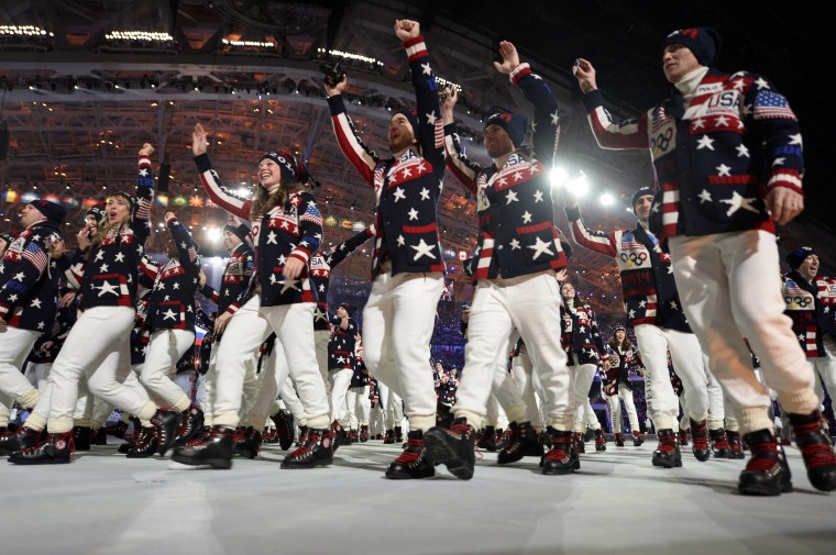 Athletes from the USA participate in the athlete march during the opening ceremony for the Sochi 2014 Olympic Winter Games at Fisht Olympic Stadium. (Robert Deutsch/USA TODAY Sports)