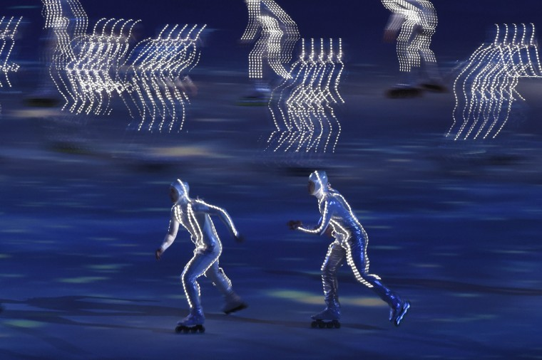 Roller skaters perform during the opening ceremony for the Sochi 2014 Olympic Winter Games at Fisht Olympic Stadium. (Robert Hanashiro/USA TODAY Sports)