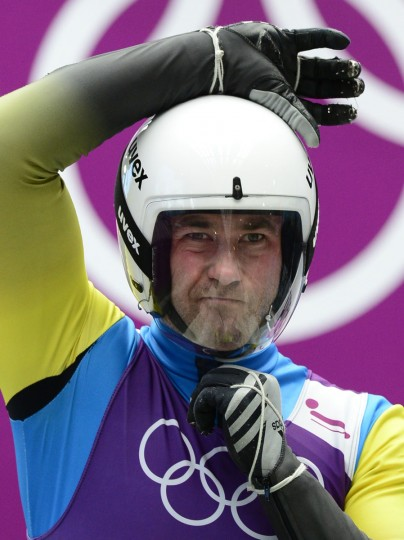 Andriy Kis (UKR) adjusts his face mask during training runs during the Sochi 2014 Olympic Winter Games at Sanki Sliding Center. (John David Mercer-USA TODAY Sports)
