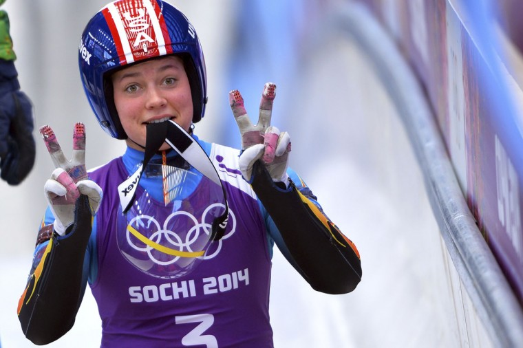 US Kate Hansen gestures during a Women Luge training session at the Sanki Sliding Centre in Rosa Khutor on February 8, 2014, during the Sochi Winter Olympics. (Leon Neal/AFP/Getty Images)