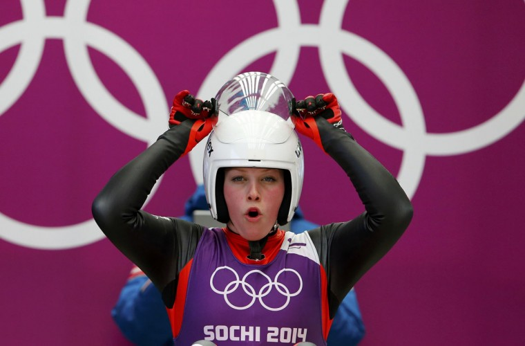 Austria's Miriam Kastlunger adjusts her helmet at the women's singles luge training session at the Sochi 2014 Winter Olympic Games at the Sanki Sliding Center February 8, 2014. (REUTERS/Arnd Wiegmann)