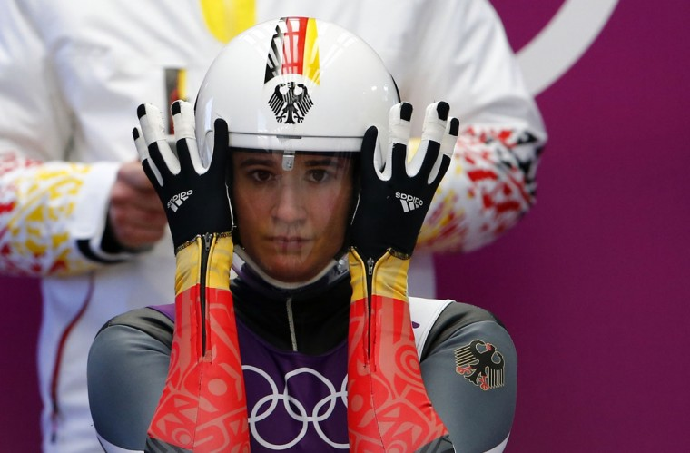 Germany's Natalie Geisenberger adjusts her helmet at the women's singles luge training session at the Sochi 2014 Winter Olympic Games at the Sanki Sliding Center February 8, 2014. (REUTERS/Arnd Wiegmann)