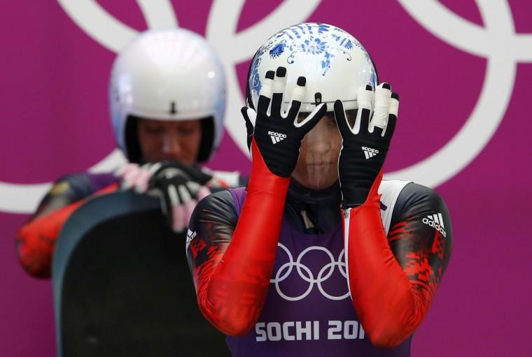 Russia's Natalja Khoreva (L) and compatriot Tatyana Ivanova wait to start their women's singles luge training session at the Sochi 2014 Winter Olympic Games at the Sanki Sliding Center February 8, 2014. (REUTERS/Arnd Wiegmann)