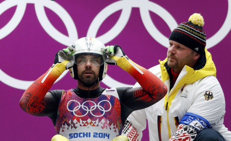 Germany's Andi Langenhan adjusts his helmet next to his coach as he prepares to start in the men's singles luge competition at the 2014 Sochi Winter Olympics, February 8, 2014.     (REUTEGermany's Andi Langenhan adjusts his helmet next to his coach as he prepares to start in the men's singles luge competition at the 2014 Sochi Winter Olympics, February 8, 2014.     (REUTERS/Murad Sezer)RS/Murad Sezer)