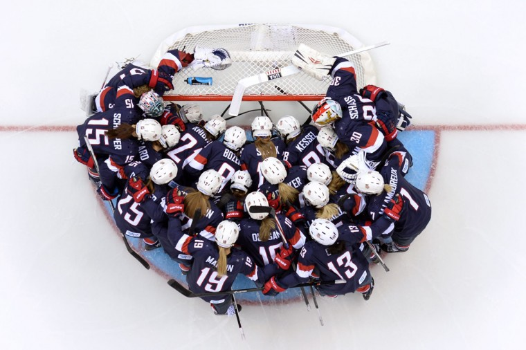 US players gather before the start of the Women's Ice Hockey Group A match USA vs Finland at the Shayba Arena during the Sochi Winter Olympics on February 8, 2014. (Jonathan Nackstrand/AFP/Getty Images)