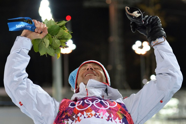 Gold medalist Norway's Ole Einar Bjoerndalen celebrates on the podium the Men's Biathlon 10 km Sprint Flower Ceremony at the Laura Cross- Country Ski and Biathlon Center during the Sochi Winter Olympics on February 8, 2014 in Rosa Khutor. Bjoerndalen equalled the record for Winter Olympic medals won when victory in the sprint in Sochi took him to 12. (Alberto Pizzoli/AFP/Getty Images)