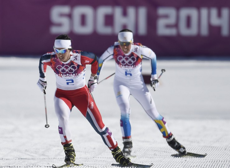 orway's Marit Bjoergen and Sweden's Charlotte Kalla compete in the Women's Cross-Country Skiing 7,5km + 7,5km Skiathlon at the Laura Cross-Country Ski and Biathlon Center during the Sochi Winter Olympics on February 8, 2014 in Rosa Khutor. (Alberto Pizzoli/AFP/Getty Images)