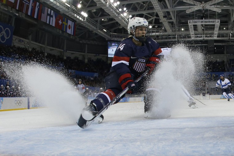US Brianna Decker fights for the puck during the Group A match USA vs Finland at the Shayba Arena against team Finland during the Sochi Winter Olympics on February 8, 2014. (AFP/Getty Images)