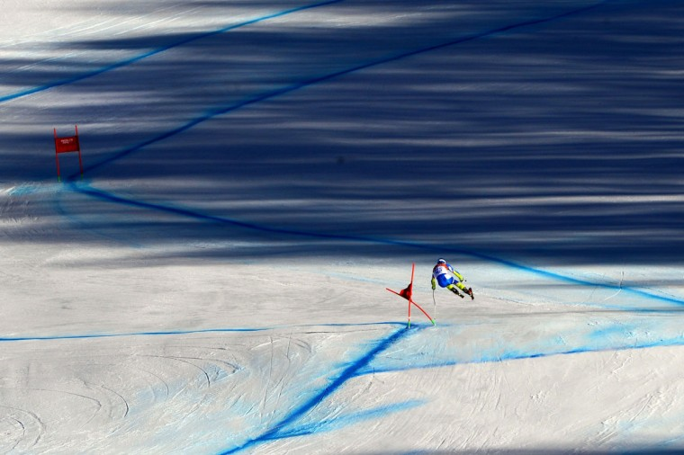 Slovenia's Klemen Kosi takes part in a Men's Alpine Skiing Downhill training session at the Rosa Khutor Alpine Center on February 8, 2014, during the Sochi Winter Olympics. (Dimitar Dilkoff/AFP/Getty Images)