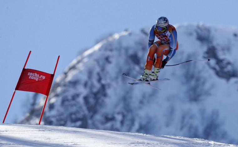 Norway's Aksel Lund Svindal goes airborne in a training session for the men's alpine skiing downhill race during the 2014 Sochi Winter Olympics at the Rosa Khutor Alpine Center February 8, 2014. (REUTERS/Stefano Rellandini)