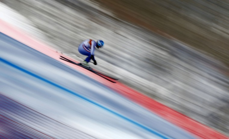 Russia's Alexander Glebov goes airborne in a training session for the men's alpine skiing downhill race during the 2014 Sochi Winter Olympics at the Rosa Khutor Alpine Center February 8, 2014. (REUTERS/Dominic Ebenbichler)