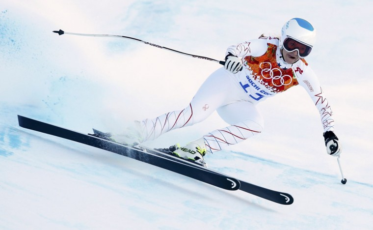Julia Mancuso of the U.S. speeds down the course in a training session for the women's alpine skiing downhill race during the 2014 Sochi Winter Olympics at the Rosa Khutor Alpine Center February 8, 2014. (REUTERS/Mike Segar)