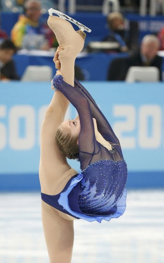 Yulia Lipnitskaya of Russia competes during the figure skating team ladies short program at the Sochi 2014 Winter Olympics February 8, 2014. (REUTERS/Lucy Nicholson)