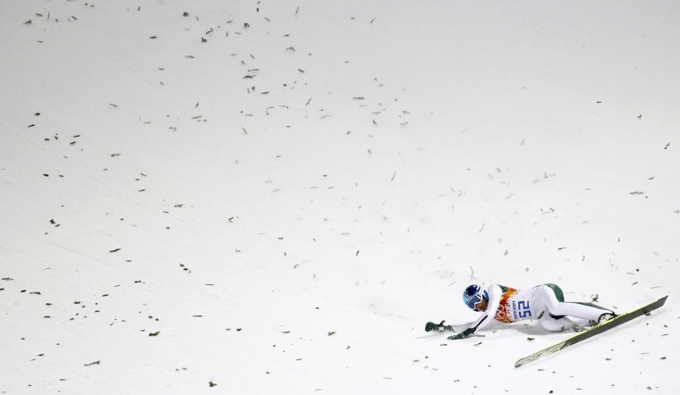 Robert Kranjec of Slovenia crashes during his jump in the men's ski jumping individual normal hill qualification round event at the Sochi 2014 Winter Olympics February 8, 2014. (REUTERS/Kai Pfaffenbach)