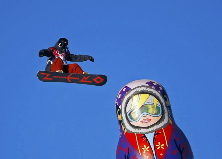 Austria's Adrian Krainer performs a jump as a giant matryoshka doll is seen below during the men's snowboard slopestyle semi-final competition at the 2014 Sochi Olympic Games in Rosa Khutor February 8, 2014. (REUTERS/Lucas Jackson)