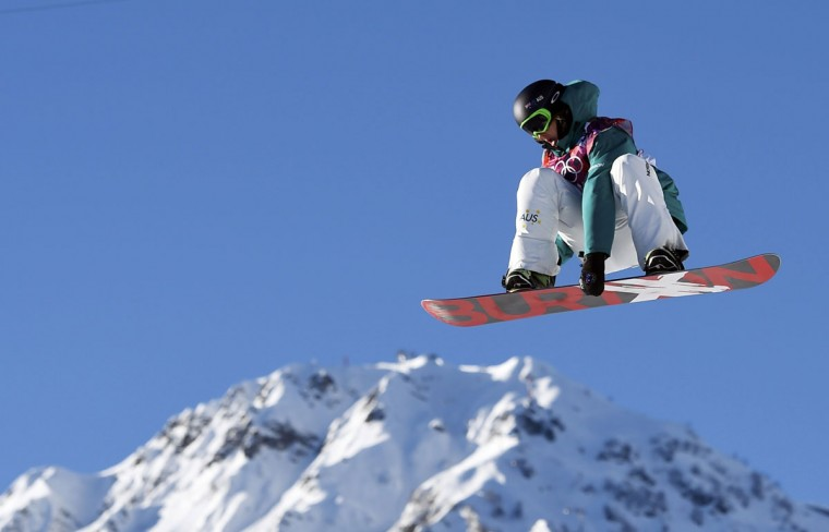 Australia's Scotty James holds onto his board as he performs a jump during the men's snowboard slopestyle semi-final competition at the 2014 Sochi Olympic Games in Rosa Khutor February 8, 2014. (REUTERS/Dylan Martinez)