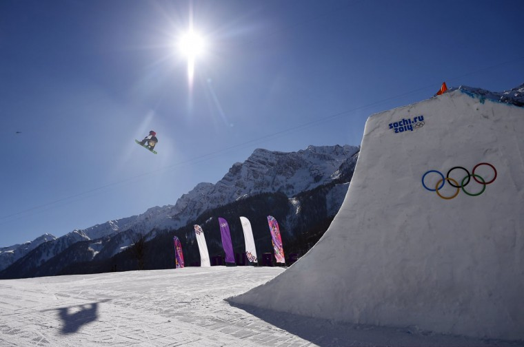 Britain's Billy Morgan performs a jump during the men's snowboard slopestyle final at the 2014 Sochi Olympic Games in Rosa Khutor February 8, 2014. (REUTERS/Dylan Martinez)