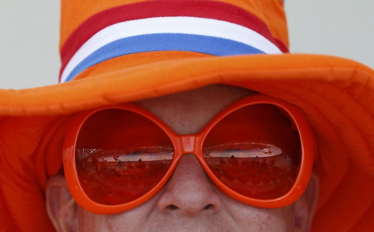 The Adler Arena is reflected in a Dutch supporters' glasses ahead of the men's 5,000m speed skating race during the 2014 Sochi Winter Olympics February 8, 2014. (REUTERS/Issei Kato)