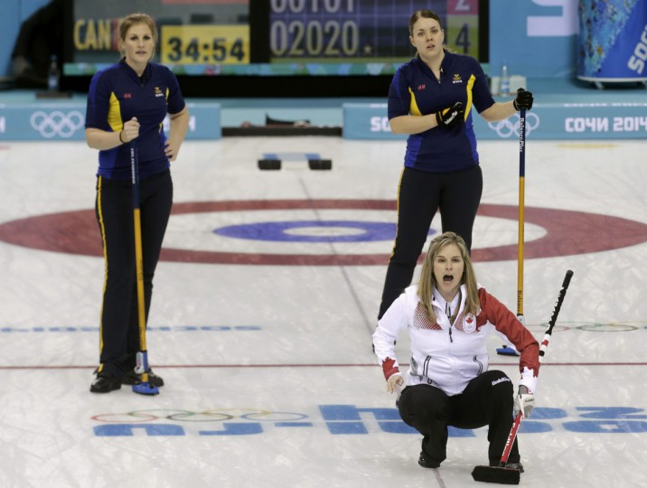 Canada's skip Jennifer Jones (front) reacts during their women's curling round robin game against Sweden at the Sochi 2014 Winter Olympic Games in the Ice Cube Curling Center February 11, 2014. (REUTERS/Ints Kalnins)