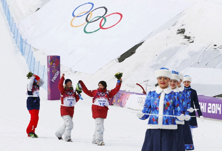 Second-placed Devin Logan of the U.S. (L), winner Canada's Dara Howell (C) and third-placed Canada's Kim Lamarre celebrate after the women's freestyle skiing slopestyle finals at 2014 Sochi Winter Olympic Games in Rosa Khutor February 11, 2014. (REUTERS/Mike Blake)