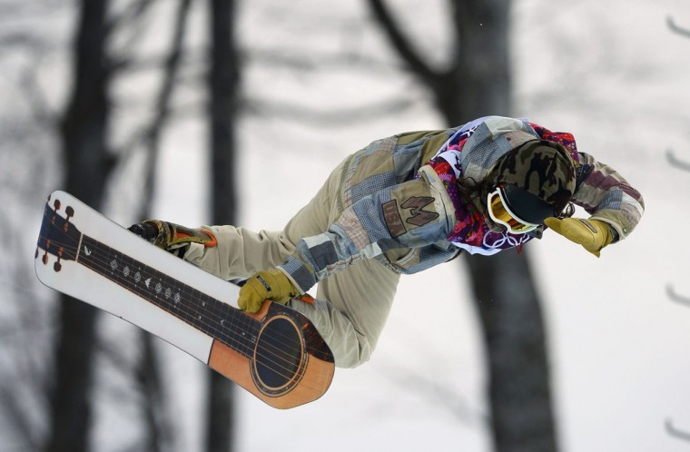 Danny Davis of the U.S. performs a jump during the men's snowboard halfpipe qualification round at the 2014 Sochi Winter Olympic Games in Rosa Khutor February 11, 2014. (REUTERS/Dylan Martinez)