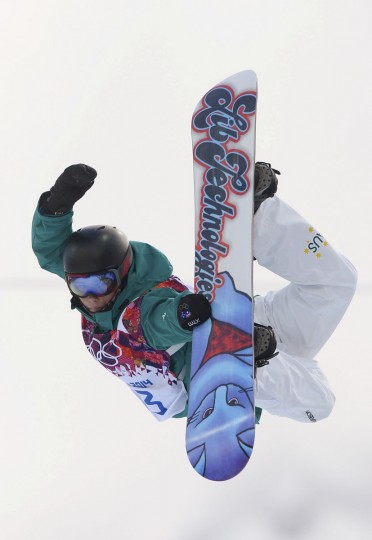 Australia's Kent Callister performs a jump during the men's snowboard halfpipe qualification round at the 2014 Sochi Winter Olympic Games in Rosa Khutor February 11, 2014. (REUTERS/Dylan Martinez)
