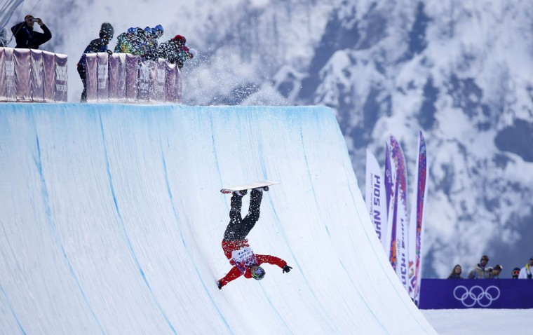 Poland's Michal Ligocki crashes during the men's snowboard halfpipe qualification round at the 2014 Sochi Winter Olympic Games in Rosa Khutor February 11, 2014. (REUTERS/Mike Blake)