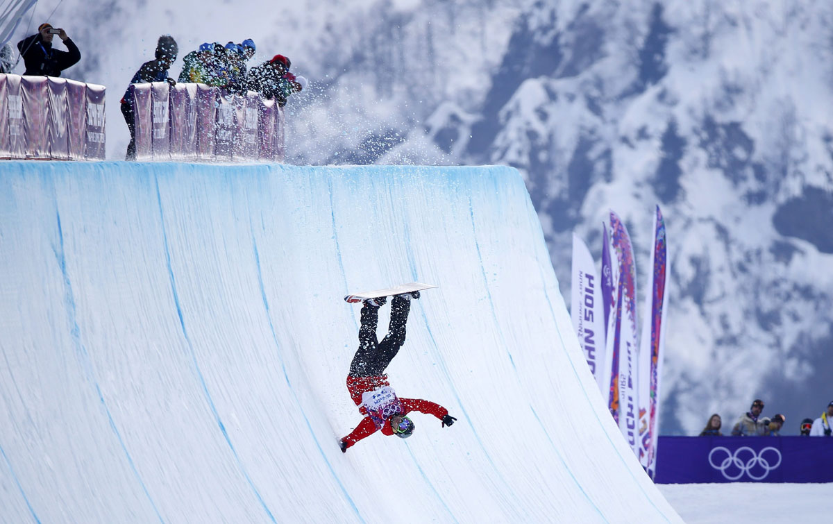 Poland's Michal Ligocki crashes during the men's snowboard ...