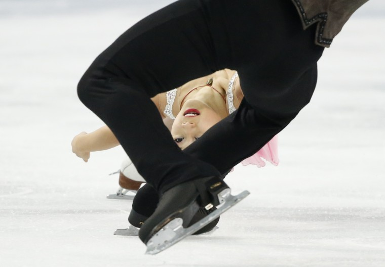 Felicia Zhang (C) and Nathan Bartholomay of the U.S. compete during the figure skating pairs short program at the Sochi 2014 Winter Olympics, February 11, 2014. (REUTERS/Lucy Nicholson)