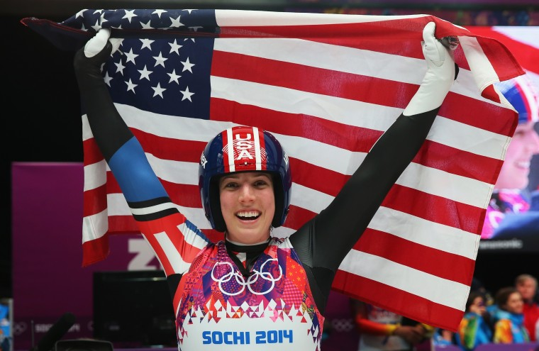 Erin Hamlin of the United States celebrates during the Women's Luge Singles on Day 4 of the Sochi 2014 Winter Olympics at Sliding Center Sanki on February 11, 2014 in Sochi, Russia. (Photo by Alexander Hassenstein/Getty Images)
