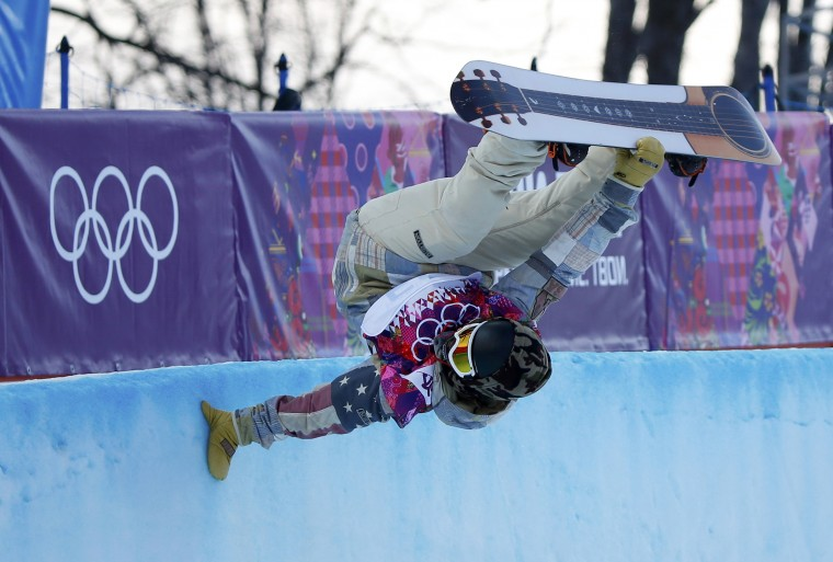 Danny Davis of the U.S. competes during the men's snowboard halfpipe qualification round at the 2014 Sochi Winter Olympic Games in Rosa Khutor February 11, 2014. (REUTERS/Mike Blake)