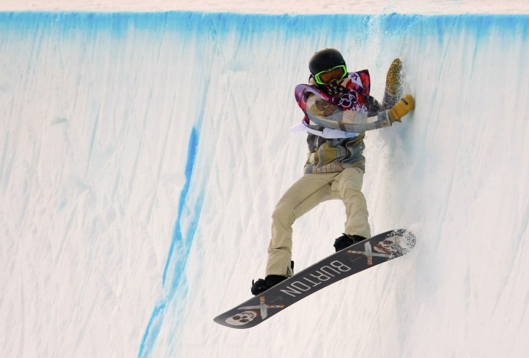 Shaun White of the U.S. competes during the men's snowboard halfpipe qualification round at the 2014 Sochi Winter Olympic Games in Rosa Khutor February 11, 2014. (REUTERS/Lucas Jackson)