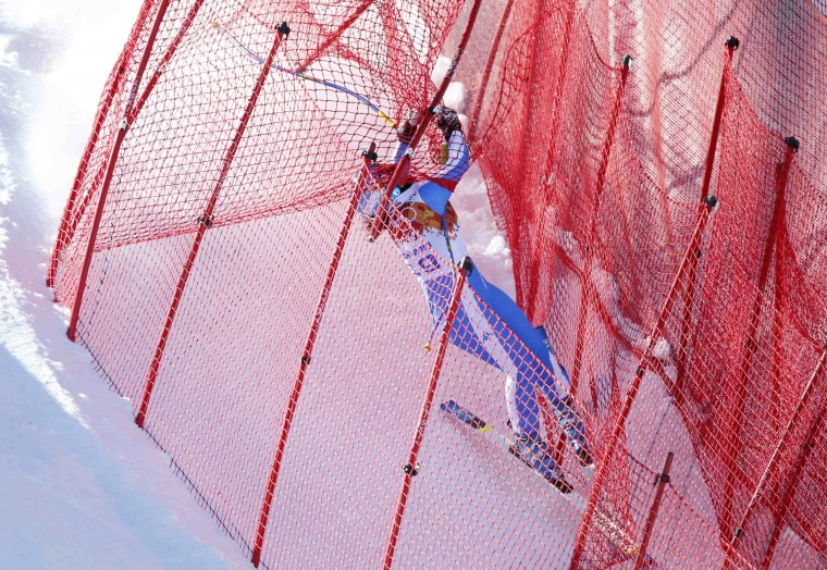 Italy's Elena Fanchini gets tangled in the safety net after crashing in the first training session for the women's alpine skiing downhill event during the 2014 Sochi Winter Olympics at the Rosa Khutor Alpine Center February 6, 2014. (REUTERS/Mike Segar)