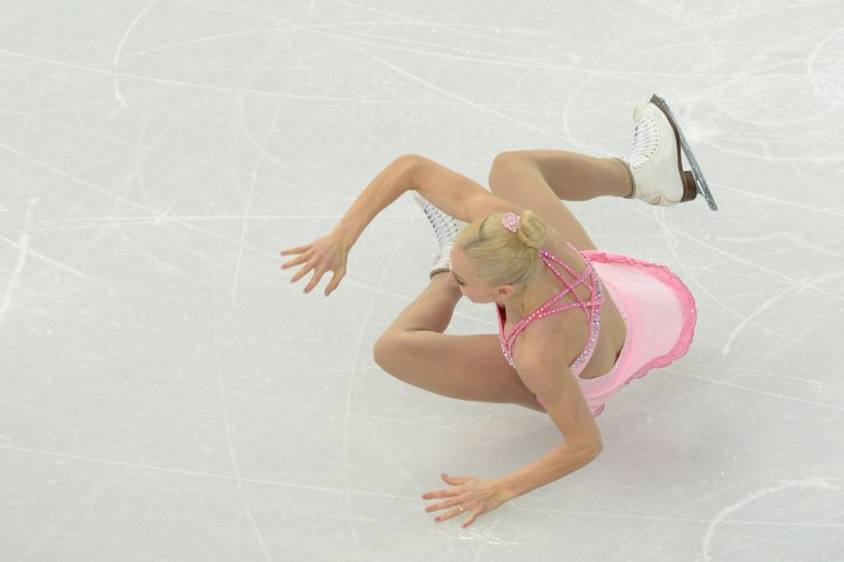 Great Britain's Stacey Kemp falls during the Figure Skating Pairs Team Short Program at the Iceberg Skating Palace during the Sochi Winter Olympics on February 6, 2014. (Yuri Kadobnov/AFP/Getty Images)