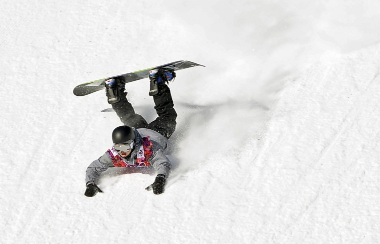 Austria's Mathias Weissenbacher crashes during the men's slopestyle snowboarding qualifying session at the 2014 Sochi Olympic Games in Rosa Khutor February 6, 2014. (REUTERS/Dylan Martinez)