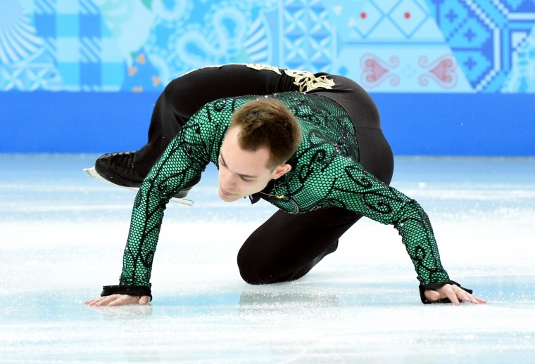 Paul Bonifacio Parkinson (ITA) falls during the figure skating team men short program in the Sochi 2014 Olympic Winter Games at Iceberg Skating Palace. (Robert Deutsch-USA TODAY Sports)