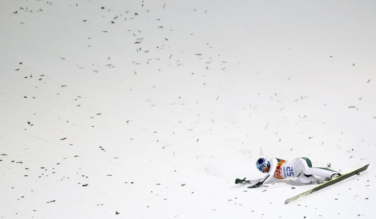 Robert Kranjec of Slovenia crashes during his jump in the men's ski jumping individual normal hill qualification round event at the Sochi 2014 Winter Olympic Games February 8, 2014. (REUTERS/Kai Pfaffenbach)