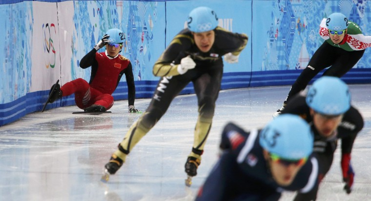 China's Shi Jingnan (L) crashes during the men's 1,500 metres short track speed skating heats event at the Iceberg Skating Palace during the 2014 Sochi Winter Olympics February 10, 2014. (REUTERS/David Gray)